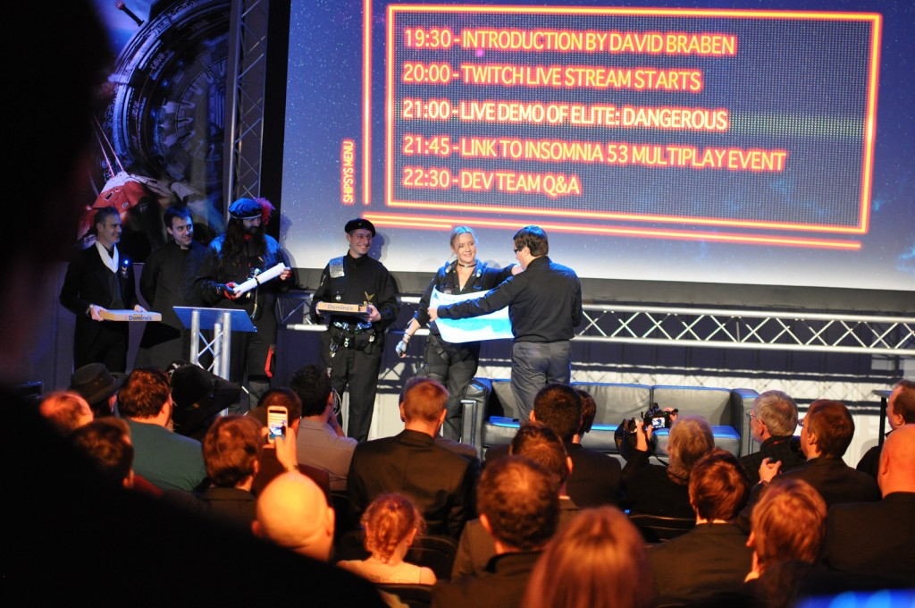 image Robisher.net - the community crew on stage handing over the space loot