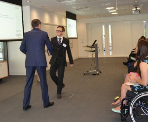 Oliver graduating from the level 3 Apprenticeship scheme & shaking hands with David Stokes, the IBM UK & Ireland general manager