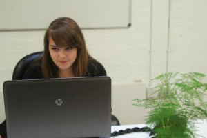 Maria at her desk working her Apprenticeship in Digital Marketing at BIMA